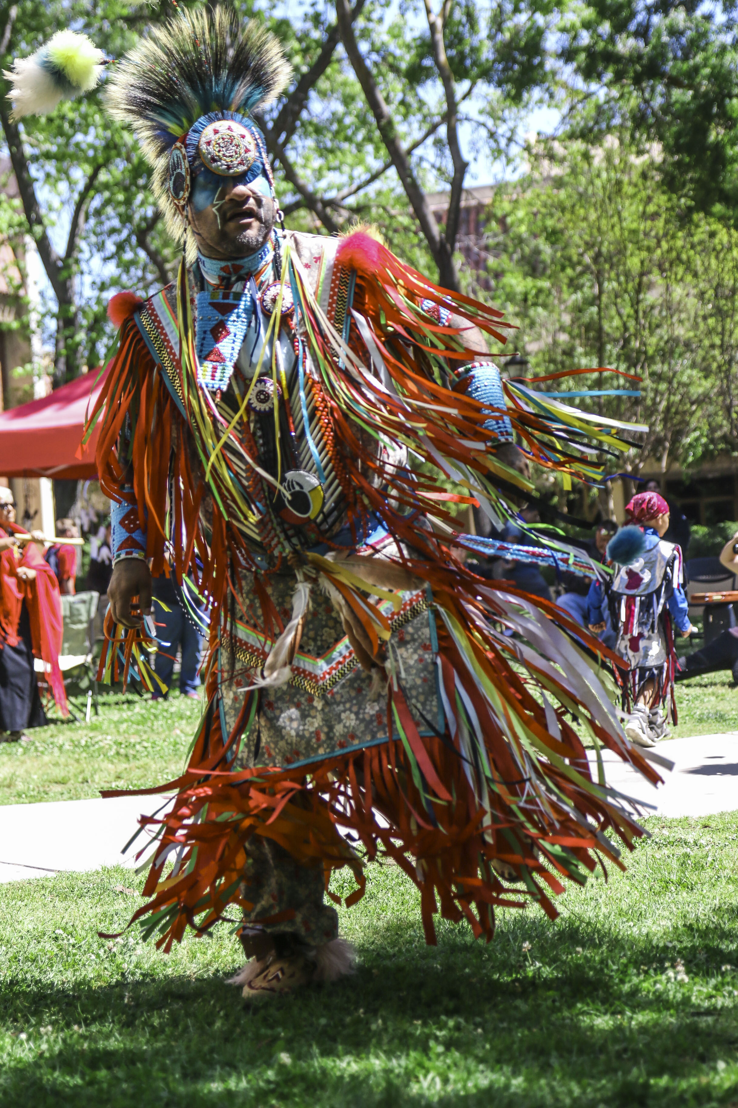 Native American dancer Little Bear showcases his traditional dance at Resistance march at Fresno City College on Thursday April 20, 2017.