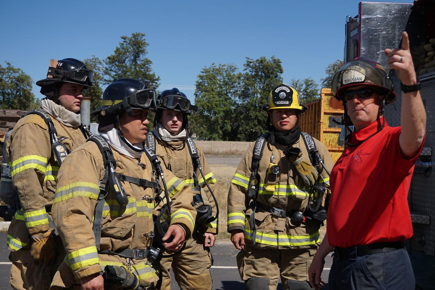 An+instructor+explains+to+the+Fresno+City+College+Fire+Academy+students+what+they+need+to+do+to+salvage+a+simulated+second+story+apartment+at+the+Clovis+Fire+Training+Center+on+Saturday%2C+April+29%2C+2017