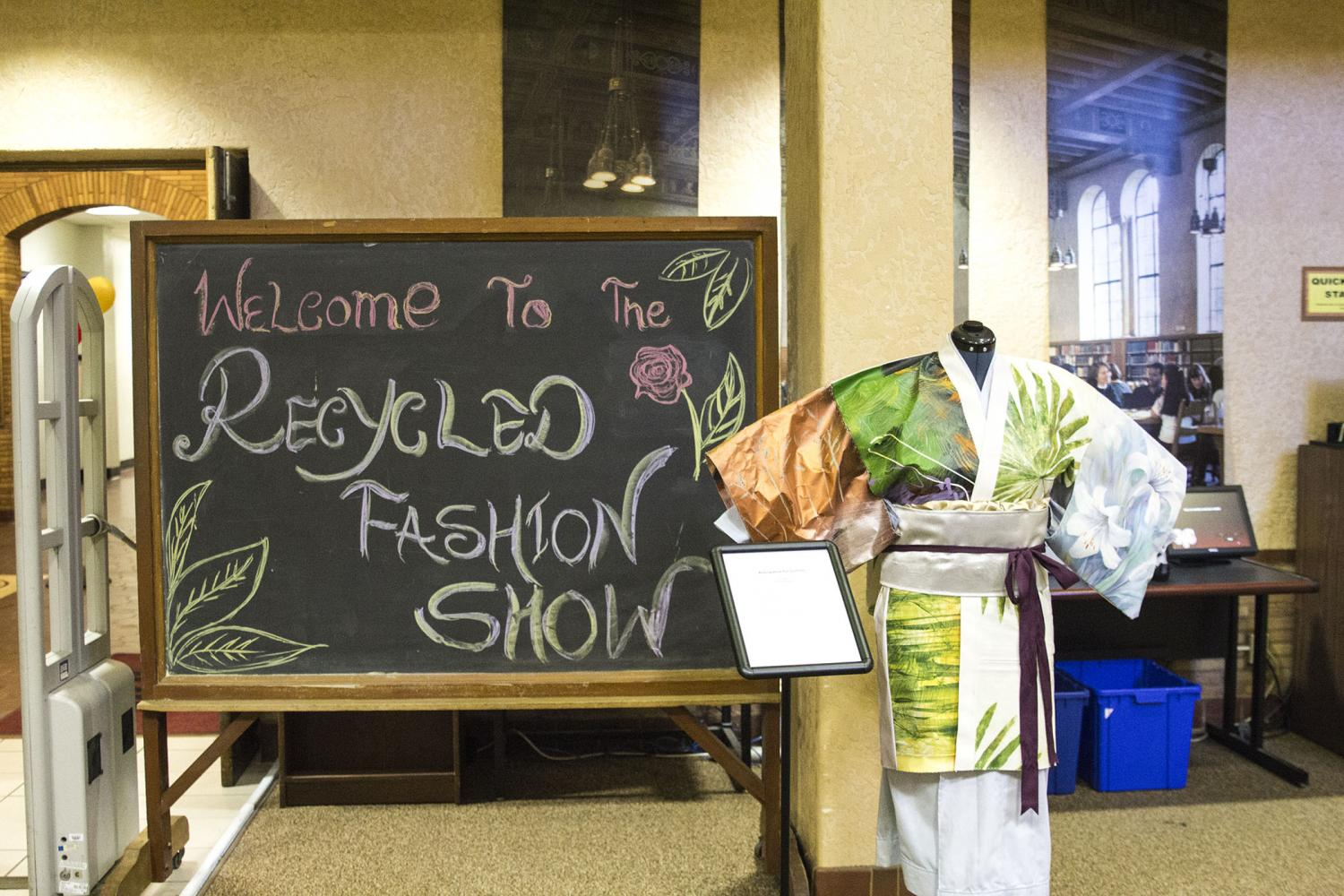 A+sign+welcomes+guests+to+the+Recycled+Fashion+Show+in+the+FCC+Library+as+a+part+of+Asian+Fest+on+April+28%2C+2017.