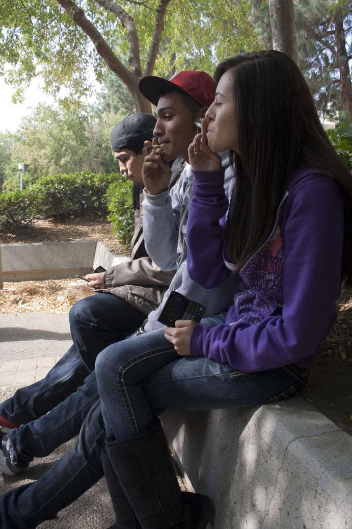 Students smoke on campus, October 20, 2010.