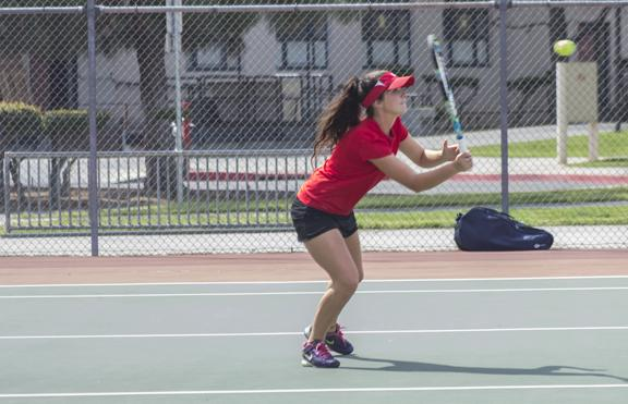 Photo By Kevynn Gomez. Lenora Pate in the Doubles Conference against Sacramento City College on March 15.