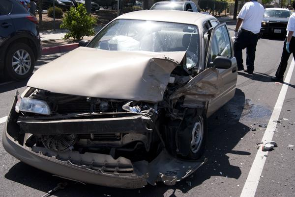 The driver, who refused to give his name, ran into another vehicle that was stopped for pedestrians to cross the street at McKinley in front of Fresno City College on April 22, 2013. (Photo/Karen West)