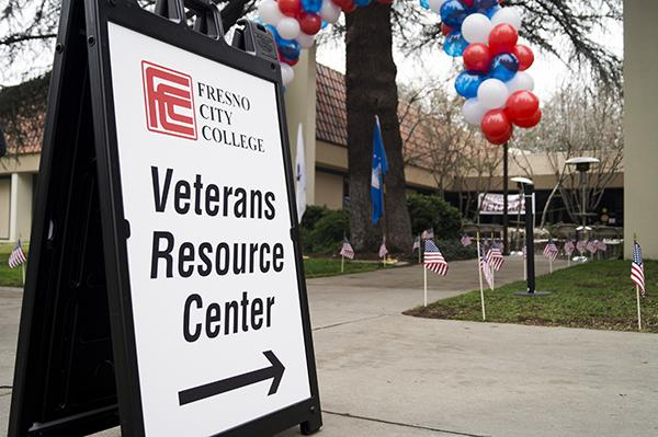 A sign points toward the Veteran's Resource Center at Fresno City College.