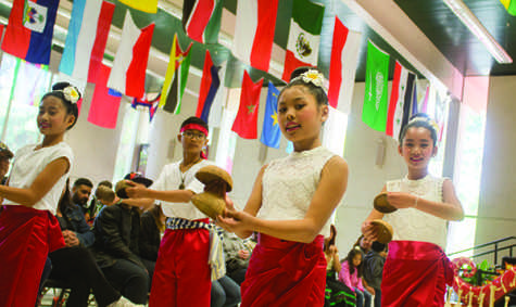 The Laos-American Community of Fresno Dancers performing during Asian Fest on Saturday, April 25, 2015 in the cafeteria on Fresno City College. Asian Fest featured many different performances from that reflect the diversity of cultures in Asia.