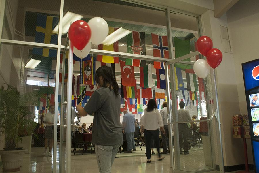 A student places red and white balloons at the entrance of the Fresno City College cafeteria during the  Fall 2015 Convocation which kicked off the new semester. The new Interim President, Cynthia Azari was welcomed by the college. August 13, 2015.