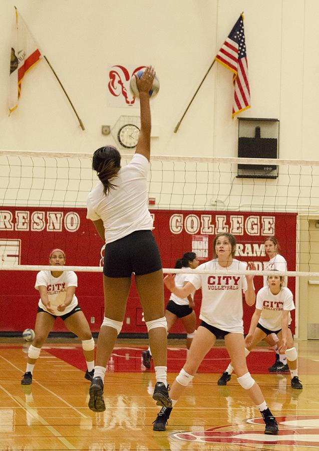 Players practice spiking over the net for harder and more precise hits, at FCC Gymnasium on Monday, Aug. 31, 2015.