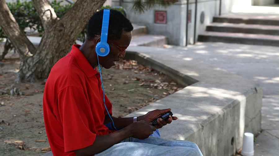 FCC Students listening to music while waiting for classes.