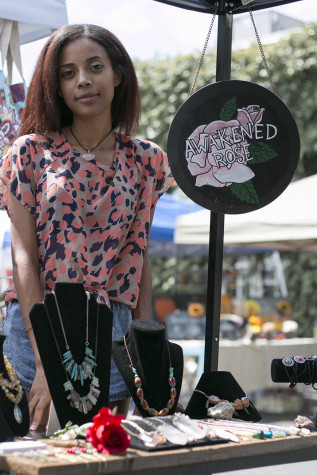 Awakened Rose founder and creator, Tayler Jenkins, posing next to her creations at the Artisan Faire at Mia Cuppa Caffe in Tower District. Sept. 13, 2015.