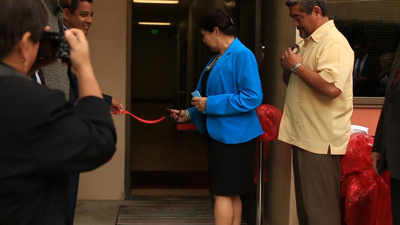 Fresno City College Interim President, Cynthia Azari cuts the ribbon for the grand opening of the DREAM Center. Sept. 29, 2015.