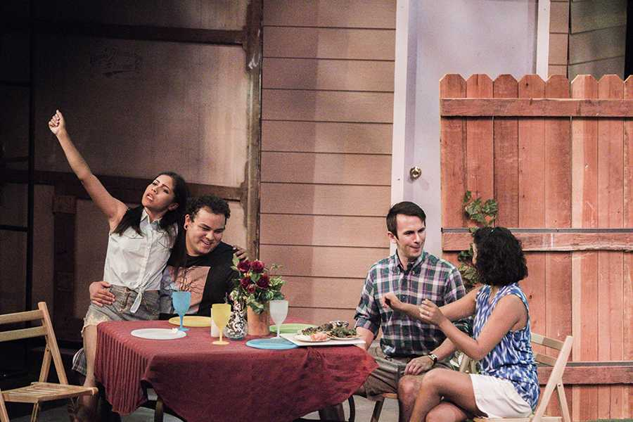Felicia Sanchez, Michael Breaud, Steve Weatherbee and Sabrina Lopez sitting around a table in the Fresno City College Theatre during a dress rehearsal for the play