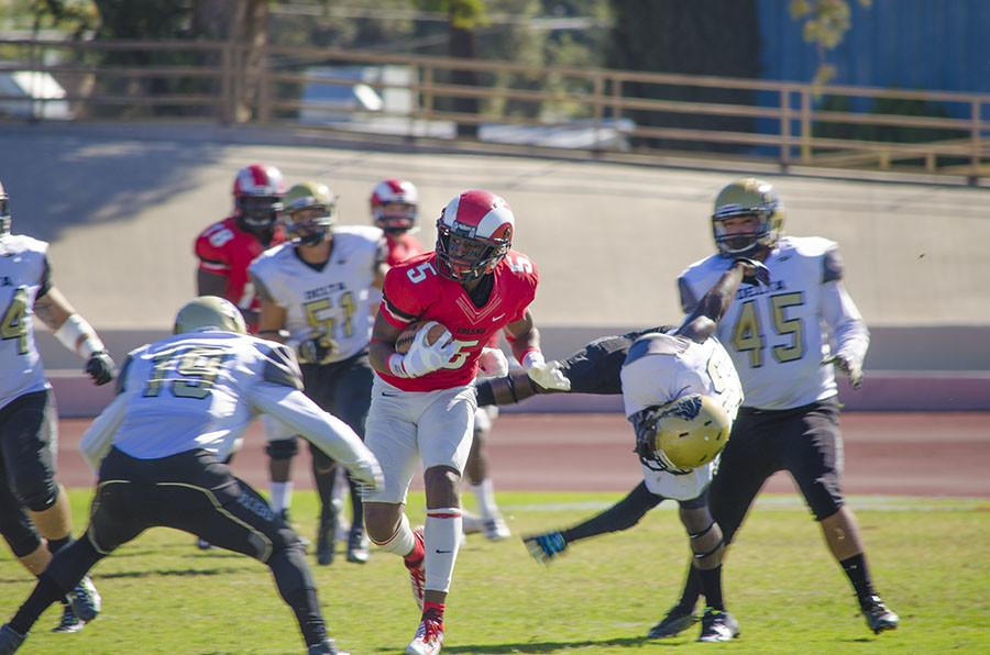Wide+receiver+James+Whitfield%2C+of+Fresno+City+College%2C+looks+for+an+opening+and+evades+running+back+Javaughn+Iverson+of+San+Joaquin+Delta+College+at+Ratcliffe+Stadium+at+the+homecoming+game+Oct.+31%2C+2015.+