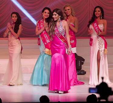 Vianey Cobian, Rampage reporter, stands on stage at the Miss Latina Global beauty pageant in Redondo Beach, CA on Nov. 22, 2015.