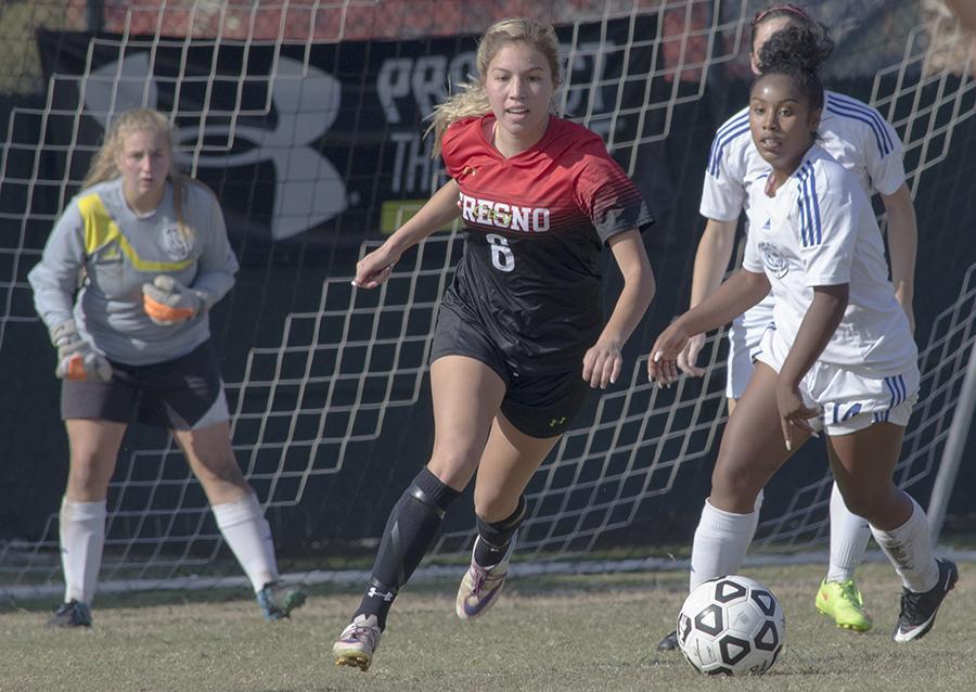 Denisse Aguirre battling with Solano forward Nicolette Nesmith.