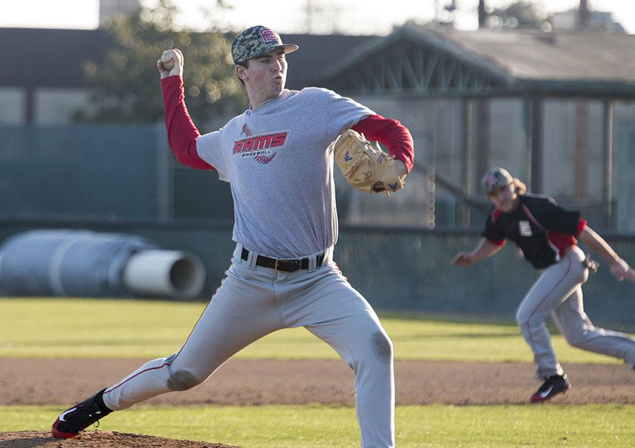 Freshman Mat Walker practices pitching at Ratcliffe Stadium on Tuesday Jan. 26, 2016.