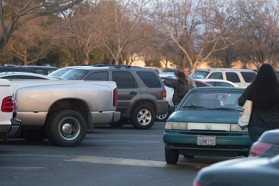 Students struggling to find a place to park at the Fresno City College parking lot D on Monday Jan.26, 2016.