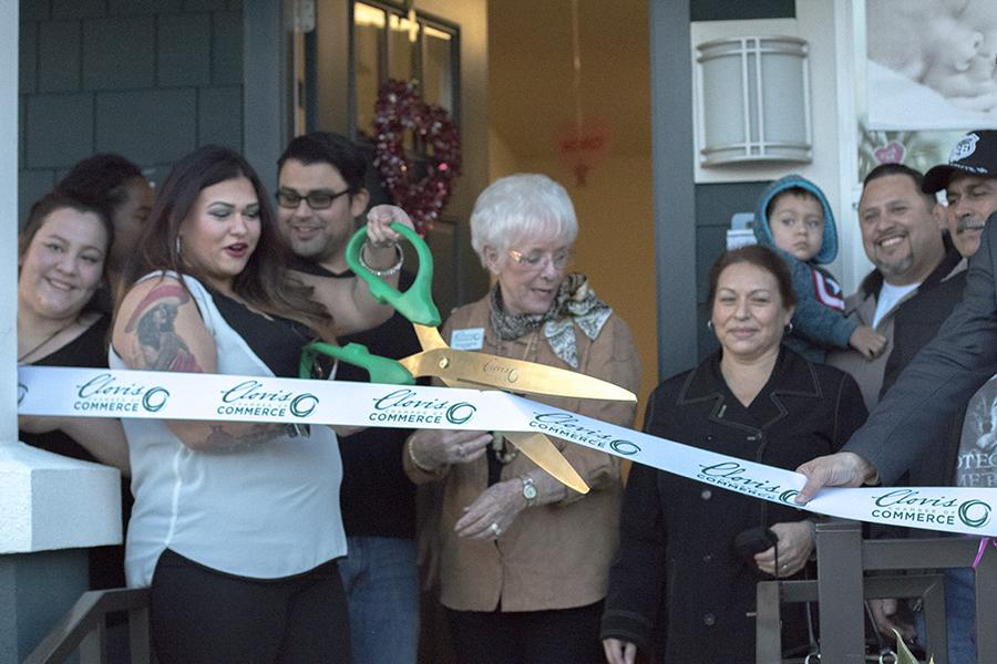 Isabel Orduno cuts the ribbon at her new photo studio, Isabel Orduno Photography located in Downtown Fresno on Thursday Feb. 4, 2016.