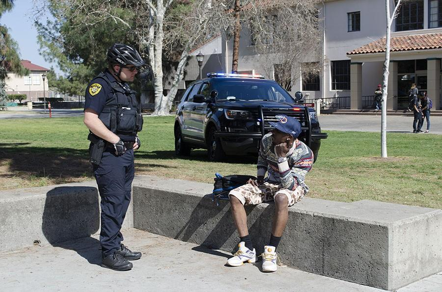 SCCCD Police speak with a man after an altercation in the Fresno City College Free Speech Area on Feb. 25, 2016.