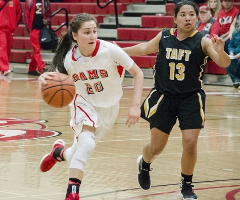 Julia Cuellar, guard for Fresno City College, maneuvers away from forward Amber Vaughn from Taft College. Saturday, Feb. 6, 2016. Photo/Daisy Rodriguez