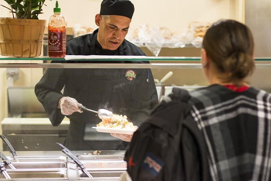 A+Fresno+City+College+Cafe+chef+serves+food+to+students+at+the+college+cafeteria+on+March+8.+Campus+eateries+have+a+history+of+extensive+inspection+violations.+