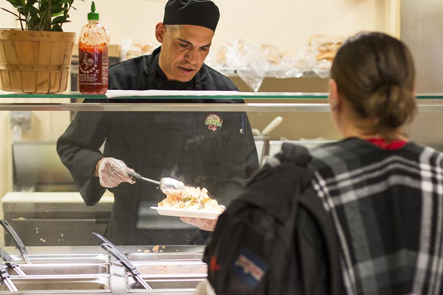 A Fresno City College Cafe chef serves food to students at the college cafeteria on March 8. Campus eateries have a history of extensive inspection violations.