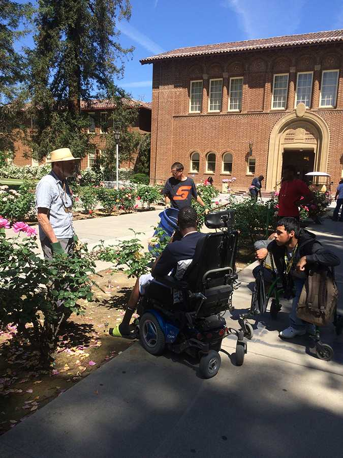 Students from the disability program at Fresno City College learn about gardening.