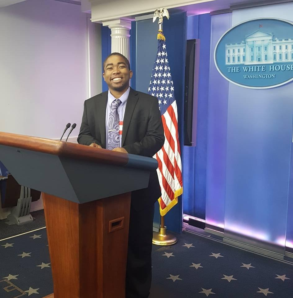 Patrick Forrest stands behind a podium before a news briefing by the White House Press Secretary, Josh Earnest at the White House College Reporter Day on April 28, 2016. U.S. President Obama also made an appearance during the briefing.