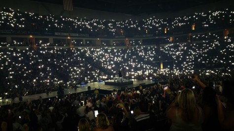 "Fans' cell phones serve as the light source while Luke Bryan performs ""Drink A Beer"" at the Save Mart Center in Fresno, Calif. on April 30, 2016, a song that deals with losing a loved one."