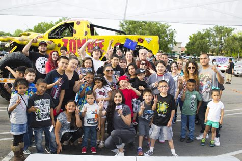 "Kimberly Marquez takes a group picture with listeners during a ""remote"" for Q97.1 FM at a Metro PCS store in Fresno, Calif. on April 7, 2016"