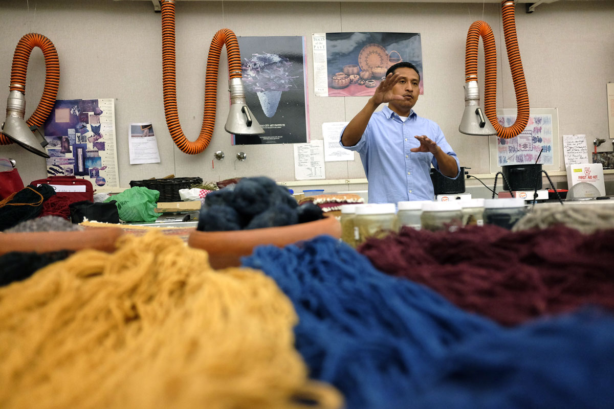 Porfirio Guitierrez explaining his natural dye process for his yarn used for his weavings in T-101 at Fresno City College on Aug. 25, 2016