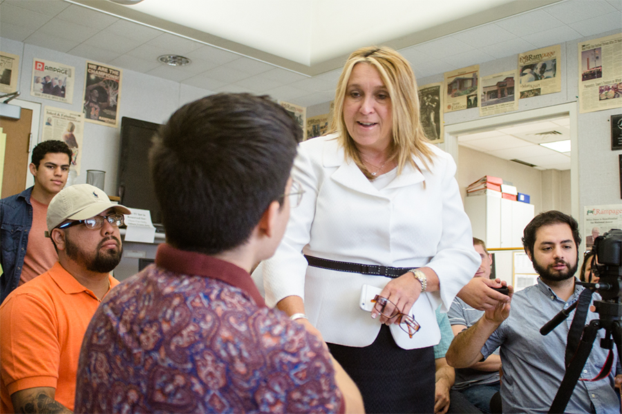 Fresno City College President Carole Goldsmith greets Rampage reporter Eric Zamora during a visit to the Rampage on Wednesday, Sept. 21 for a question and answer session with the staff.