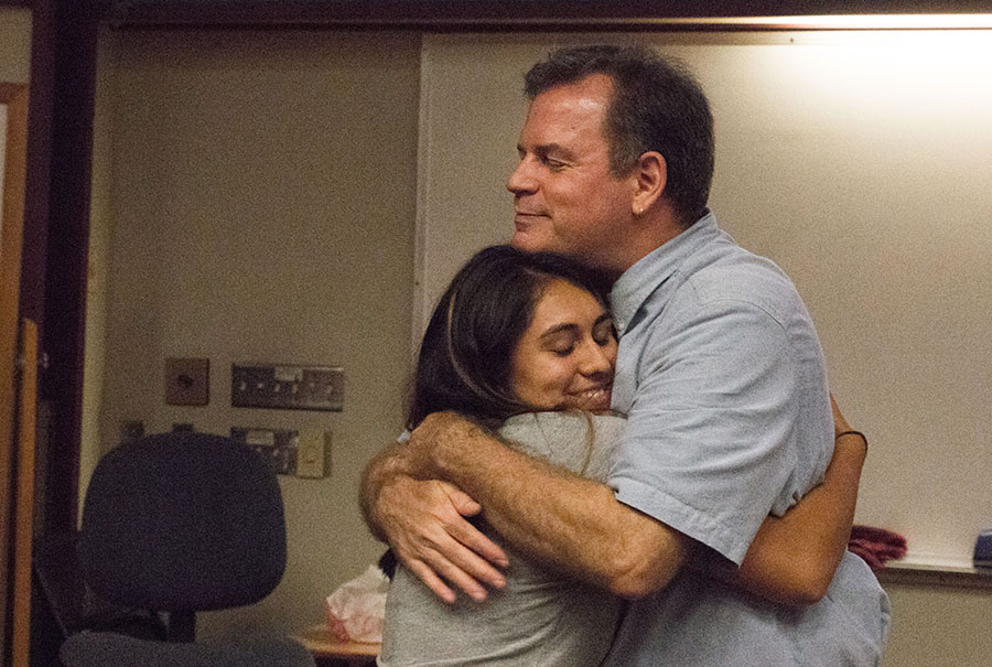 Eric Field, survivor of the Sept. 11, 2001 attacks on the World Trade Center in New York, hugs a student during a speech at Fresno City College.