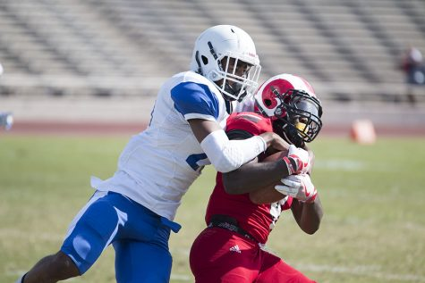 Rams running back Nate Jones breaks a tough run in his teams tough loss to Modesto Junior College during homecoming game.