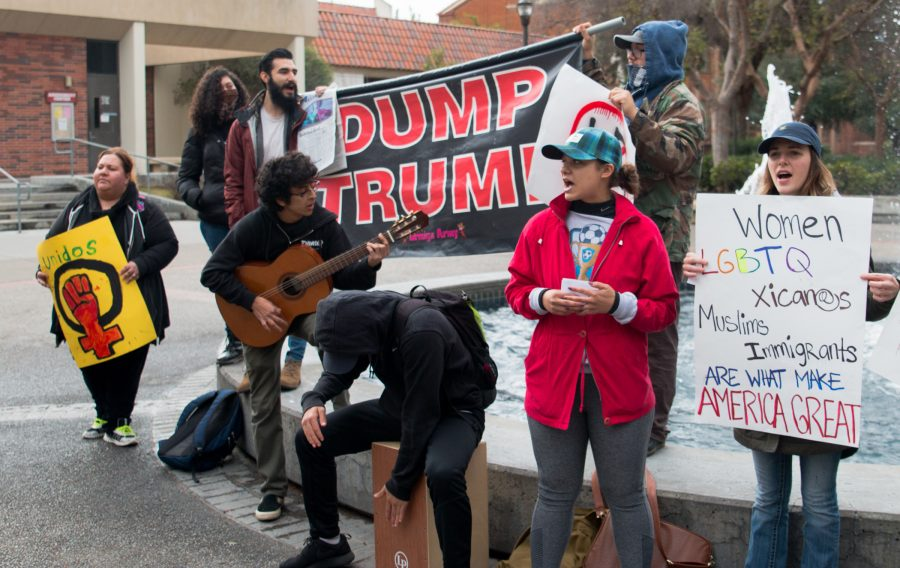 Fresno City College students protest the inauguration of Donald Trump at the FCC fountain on Friday, Jan. 20, 2017
