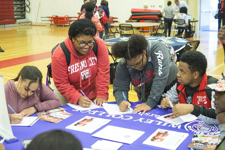Students gather around the Wiley College table at the Historically Black Colleges and Caravans event in the FCC gym on Tuesday, Feb. 14, 2017