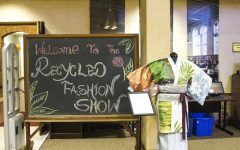 A sign welcomes guests to the Recycled Fashion Show in the FCC Library as a part of Asian Fest on April 28, 2017.