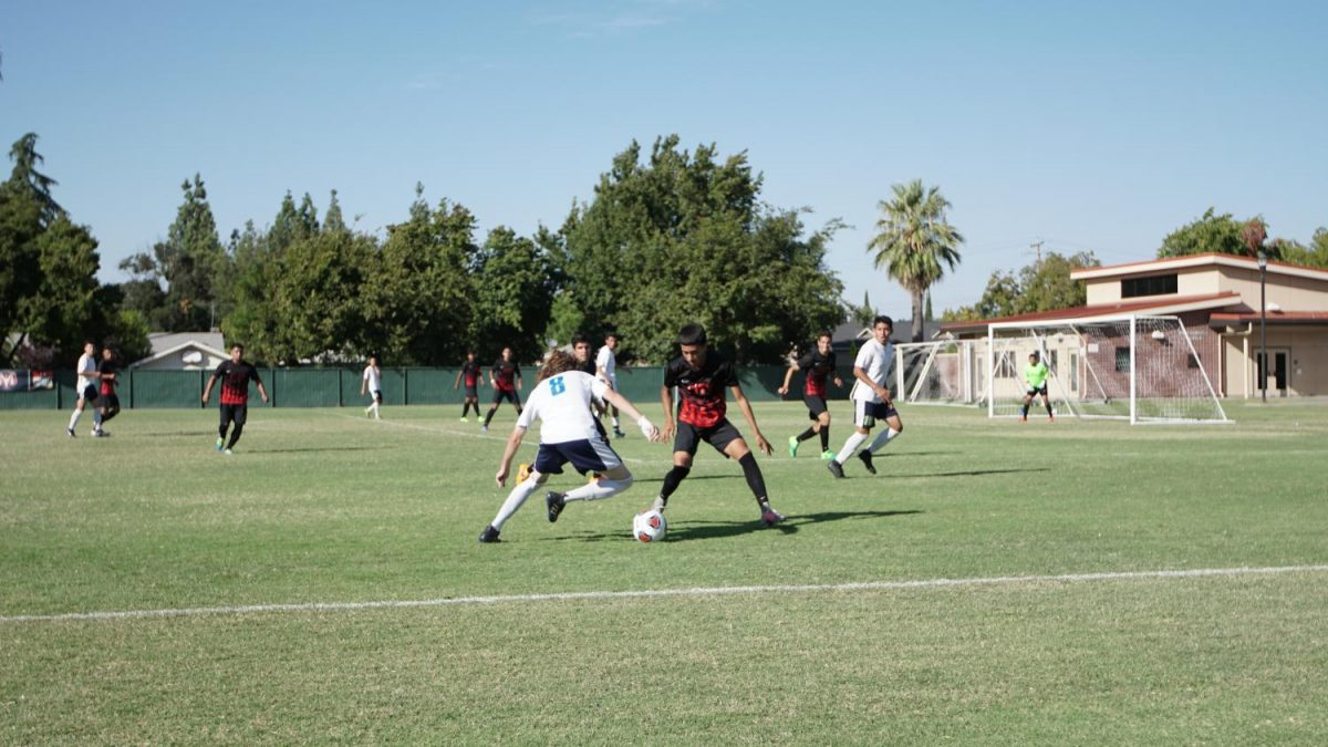Fresno+City+College+defender%2C+right%2C+maintains+his+position+during+a+home+game+against+Clovis+Community+College+on+Tuesday%2C+Sept.+26%2C+2017.