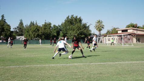 Fresno City College defender, right, maintains his position during a home game against Clovis Community College on Tuesday, Sept. 26, 2017.