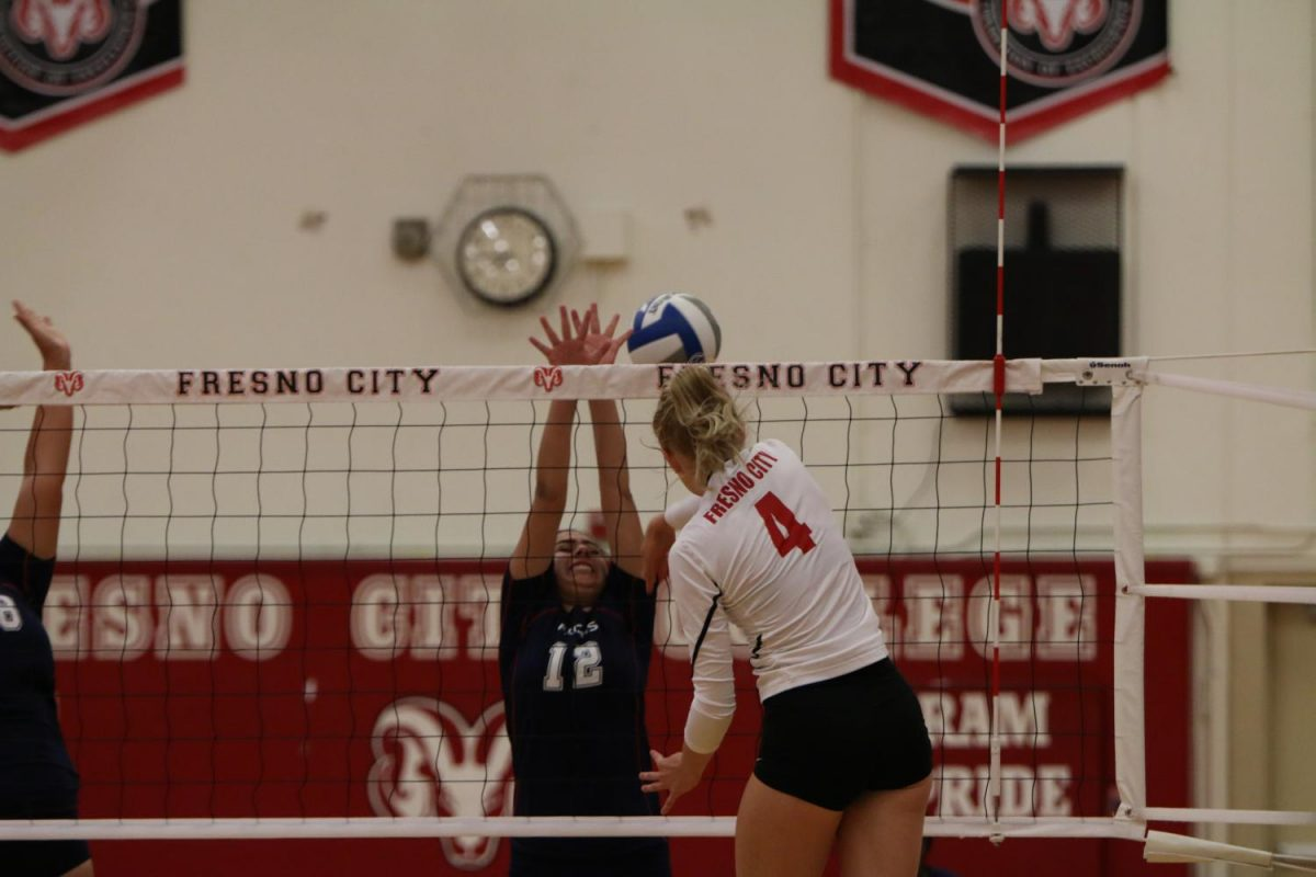 Fresno City College right side hitter Mia Corippo is spiking the ball in front of a West Hills player during the Sept. 20, home game.