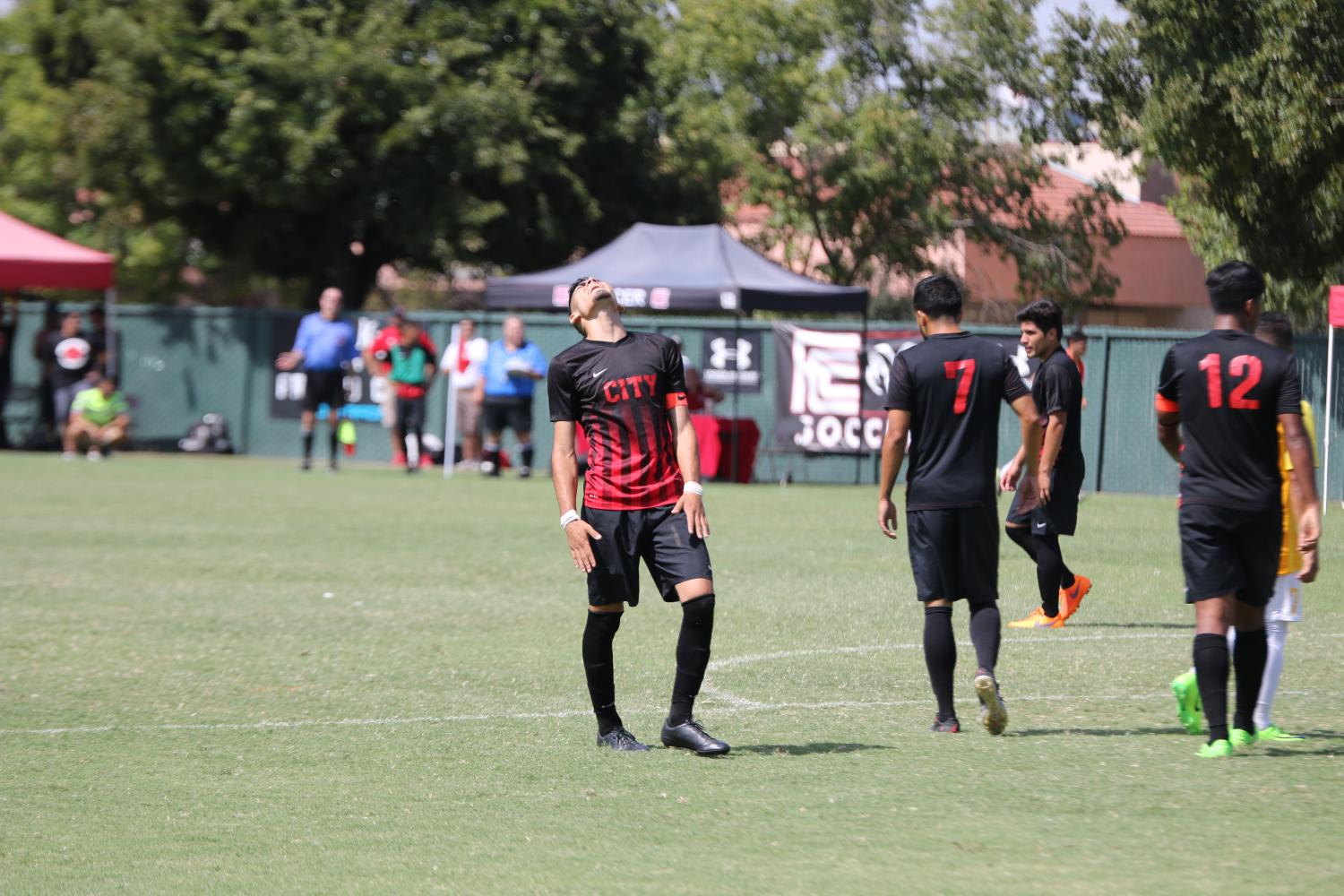 Ram's men's soccer players show their frustration after not being able to keep the lead during a tied game against Cañada College at home on Saturday, Sept. 16, 2017.