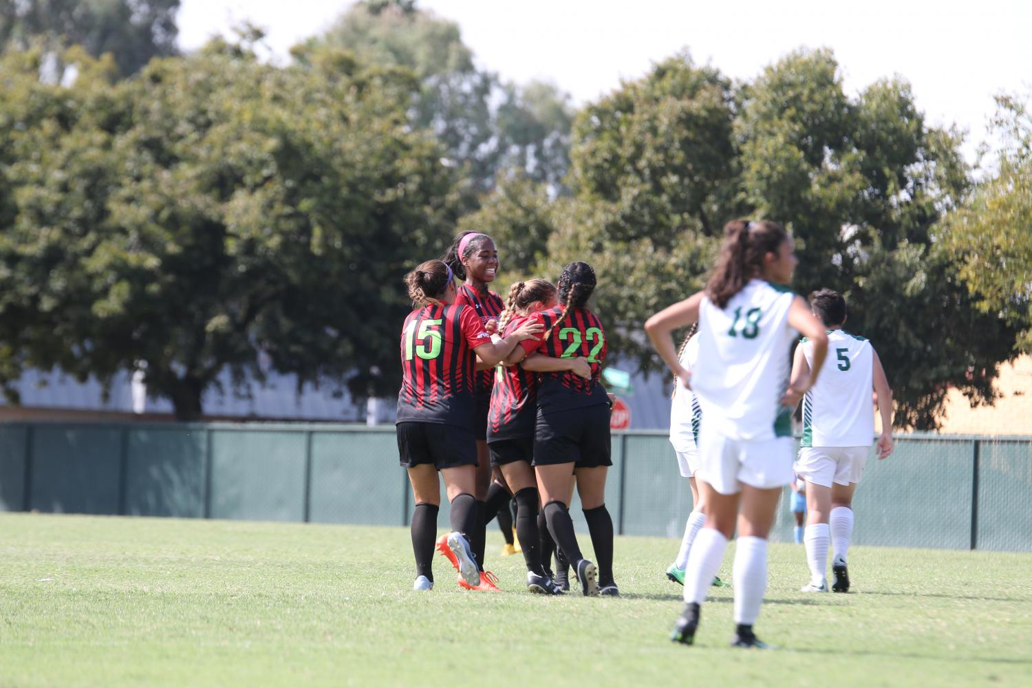 Fresno City College Women's Soccer celebrate after scoring a goal against Evergreen Valley College on Saturday Sept. 16, 2017.