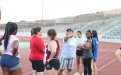 Coach Hope Villines instructs FCC's new cheer team during practice at Ratcliff Stadium.