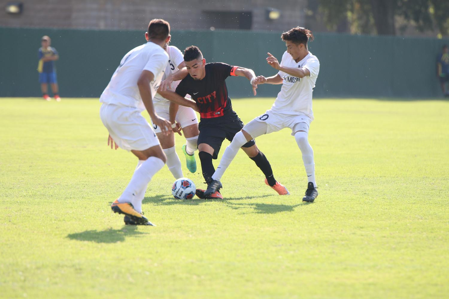 Ram's forward Johnny Rodriguez trying to get away from three LA Mission defenders on Sept. 8.