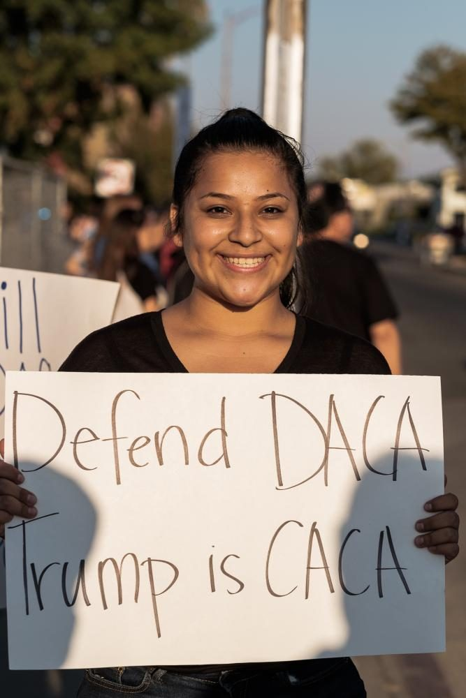I am a high school student and I see others students who are under DACA and that go to school to my school. I saw how they had improved their lives, they learn how to speak English and a lot of things that they werent able to do when they got here. Genesis Parra holds up a sign during the March to Defend DACA at Fresnos Tower District on Sunday, Sept. 15, 2017.