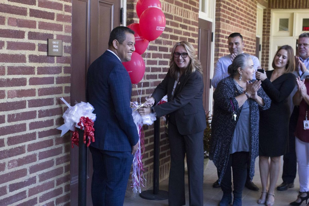 From left: SCCCD Trustee Miguel Arias, FCC President Carole Goldsmith and Dream Center counselors cut the ribbon to officially open the Dream Center in OAB 137 on Thursday, Sept. 21, 2017.