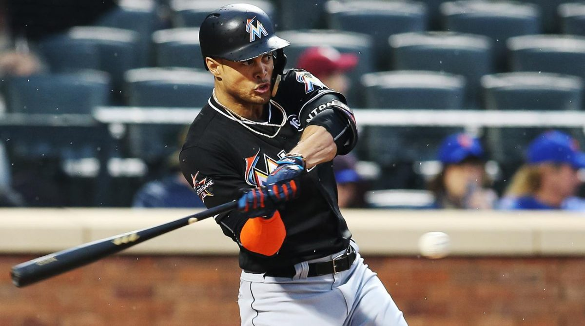 Miami+Marlins+outfielder+Giancarlo+Stanton+swinging+at+the+ball.