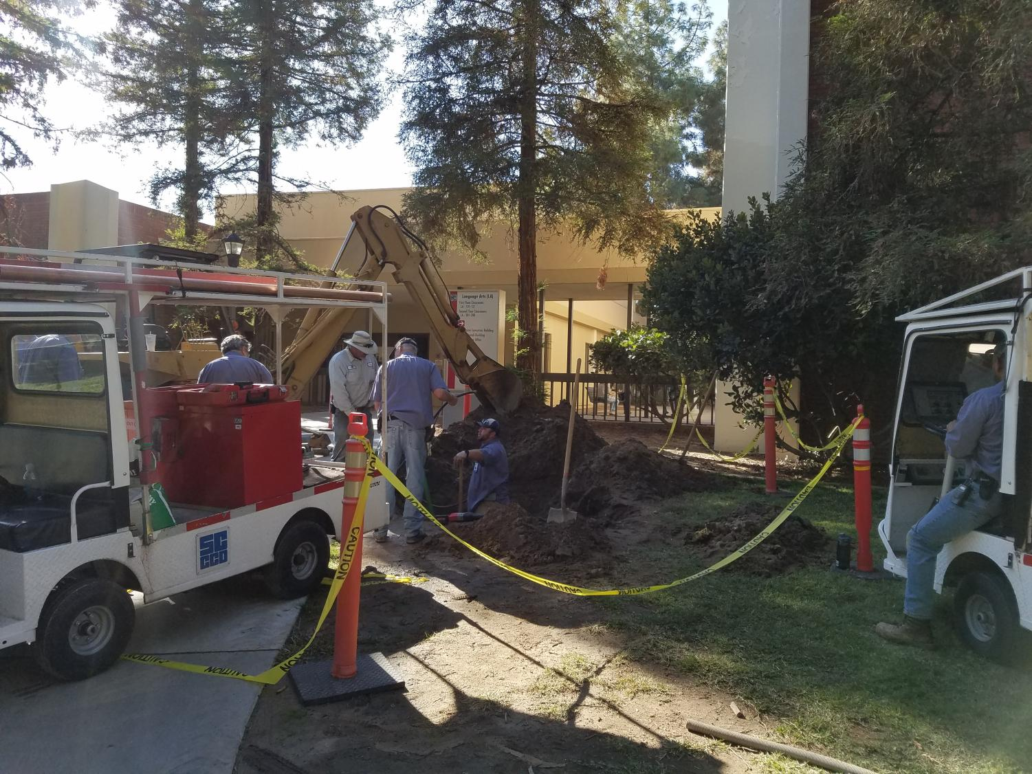Maintenance crews work on a chilled water line leak near the Language Arts building at Fresno City College on Wednesday, Oct. 25, 2017.