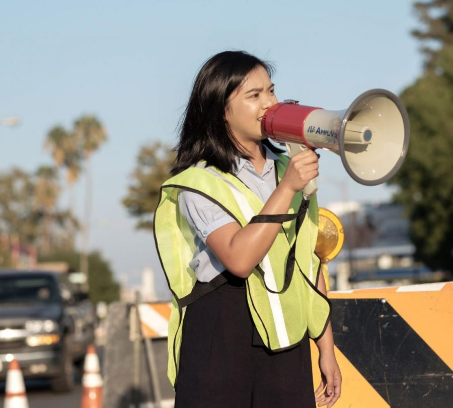 Sophia Bautista speaks to the crowd during a protest she organized in Fresno's Tower District on Sunday, Sept. 17, 2017.