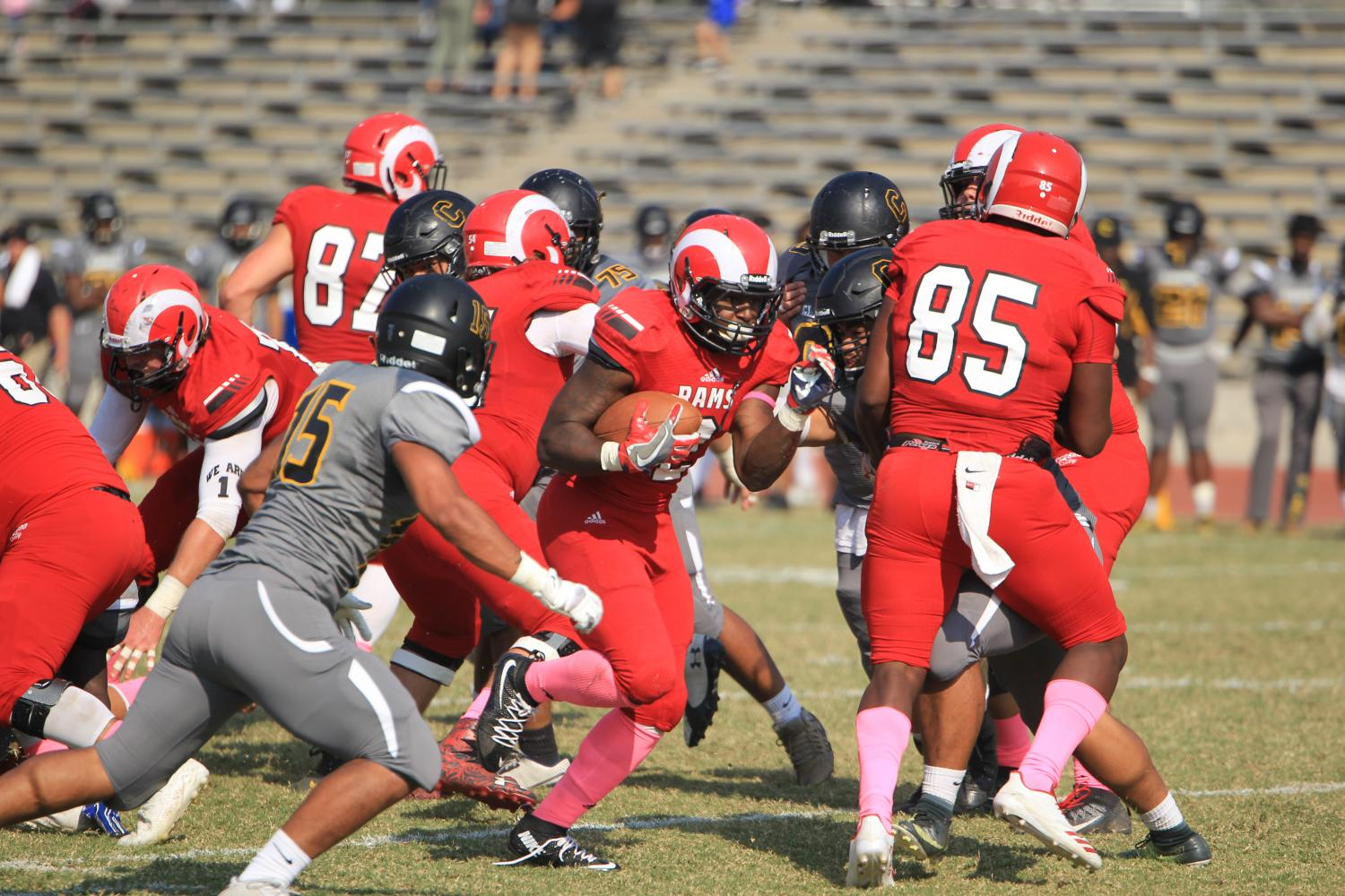 Fresno City College running back Khai Williams gets through the Chabot College's defensive line during homecoming game at Ratcliff stadium on Saturday, Oct. 14, 2017.