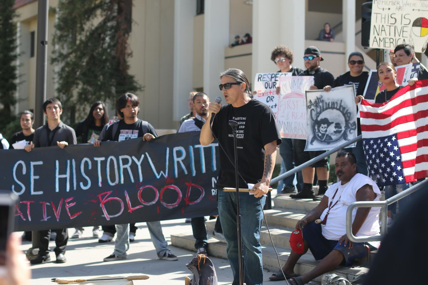 American-Indian studies instructor Bernard Navarro speaks at FCC's main fountain stage about the Native American community's thoughts about Columbus Day on Monday, Oct. 9, 2017.