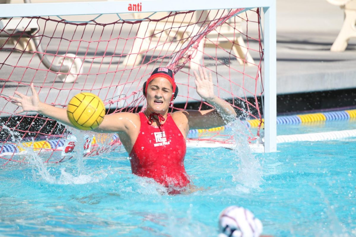 Fresno City College goalie Candice Islas stops a shoot on goal from an American River College player at home on Thursday Sept. 29, 2017
